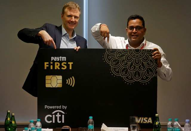 Vijay Shekhar Sharma, founder of Paytm's parent One97 Communications, and Citibank's global consumer banking Chief Stephen Bird gesture as they launch a Citibank and Paytm credit card in Mumbai, India, May 14, 2019. REUTERS/Francis Mascarenhas