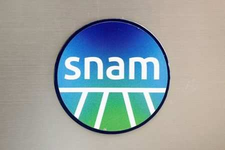 Italian gas group Snam logo is seen outside their office in Rome, Italy, June 4, 2020. REUTERS/Guglielmo Mangiapane/Files