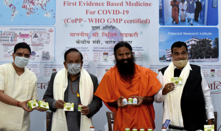 (From left) Patanjali Ayurved chairman Acharya Balkrishna, Union health minister Harsh Vardhan, Yoga teacher Ramdev and transport minister Nitin Gadkari while releasing the 'first evidence-based medicine for Covid-19 by Patanjali'. ( ANI)