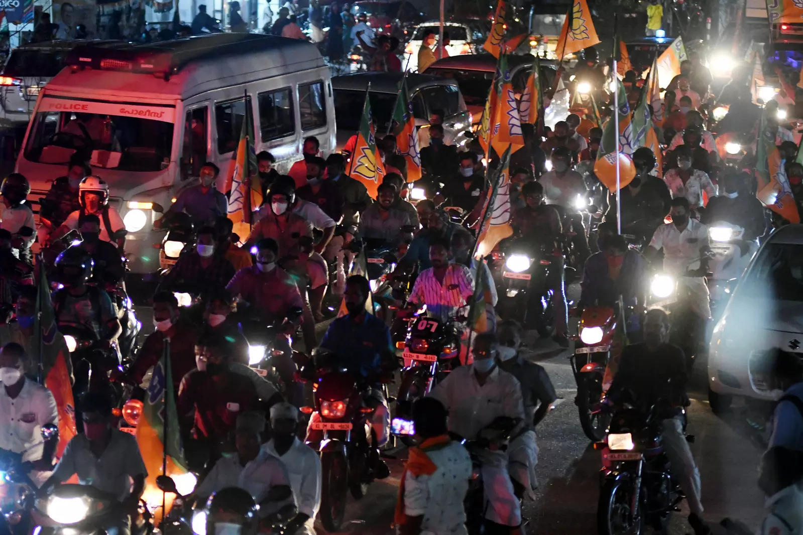 BJP supporters during a roadshow of BJP National president J.P.Nadda ahead of Kerala assembly polls, in Thiruvananthapuram.