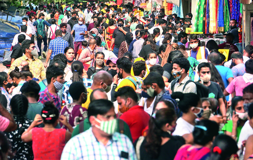 As crowds swell, AIIMS chief warns of early 3rd Covid wave