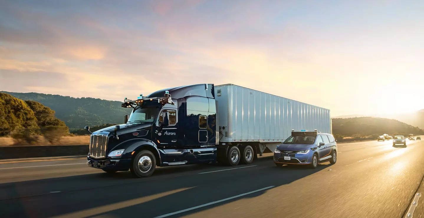 Aurora will begin piloting trucks loaded with its software this week to haul goods for FedEx Corp, albeit with a safety driver.