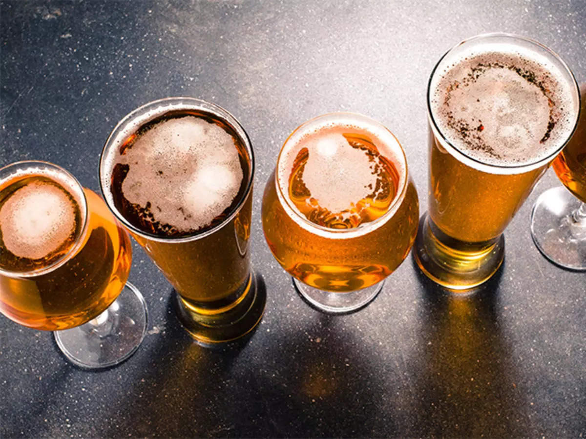 beer companies: cci slaps rs 873 cr fine on ubl, carlsberg india, others for cartelisation in beer sale, retail news, et retail