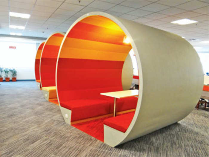 google slide in office. companies like google linkedin turn office spaces into happy zones for their young employees retail news et slide in o