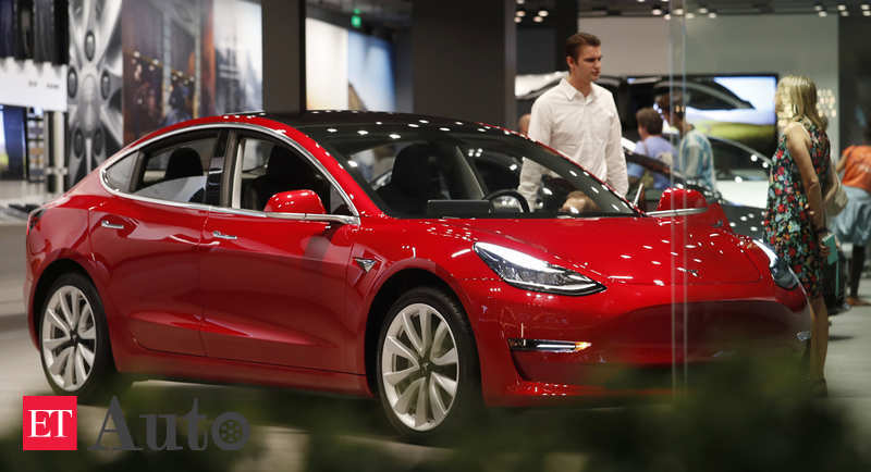 tesla model 3: Tesla knocks off $1,100 from Model 3 price